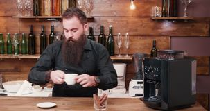 The Perfect Coffee. Stock video is an awesome piece of footage that displays a bartender making the perfecrt cup of coffee using a state of the art coffee maker stock footage