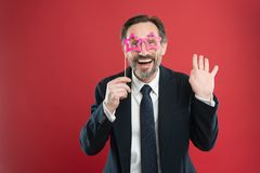 Perfect for corporate party. Handsome mature man wear fake glasses accessories. Funny businessman in party photobooth stock photos