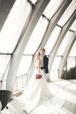 Perfect couple bride, groom posing and kissing in their wedding day Royalty Free Stock Photography