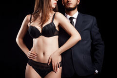 Perfect couple women in underwear and men in costume Royalty Free Stock Photography
