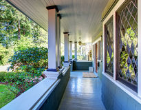 Perfect covered front porch woth decorative windows. Stock Photos