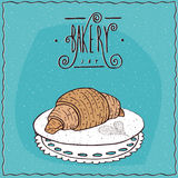 Perfect croissant lie on lacy napkin Stock Image