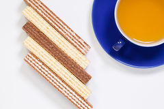Perfect cup of tea on wooden table with sweet wafers Stock Images