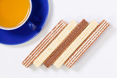 Perfect cup of tea on wooden table with sweet wafers Royalty Free Stock Photography