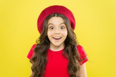 Perfect curls. Kid cute face with adorable curly hairstyle wear beret hat. Little fashionista. Little girl grow long. Hair. Styling of curly hair. Hairdresser royalty free stock image