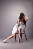 Perfect dancer in white cloth sit on chair Stock Photos