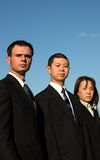 Perfect day. American and asian business people standing with a nice blue sky behind them Stock Photos
