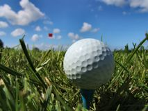 A perfect day for golf. Closeup of golfball on a sunny summerday Royalty Free Stock Photo