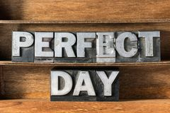 Perfect day tray. Perfect day phrase made from metallic letterpress type on wooden tray royalty free stock photos