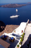 Perfect dinner spot. The perfect dinner spot, two tables on the high rocks of Santorini, watching the volcano and waiting for dinner time. Slight overexposure of stock photos