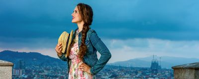 Traveller woman in front of city panorama looking into distance Stock Photography