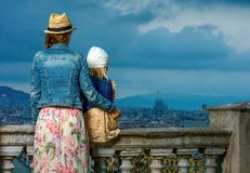 Elegant mother and daughter in Barcelona looking into distance Stock Images
