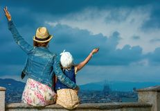 Mother and child against cityscape of Barcelona rejoicing Stock Photography