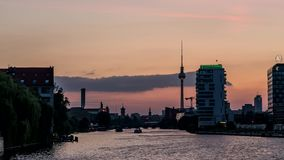 Perfect evening to night Timelapse of Berlin via the River Spree. The Oberbaumbrücke in Berlin Treptow-Friedrichshein offers a perfect view at Nighttime towards stock video footage