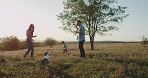 Perfect family time , mom and dad making bubbles for their two sons, one year old and three years old. 4k stock footage