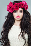 Perfect Fashion Model with Long Permed Curly Hair. And Fashion Makeup. Nice Woman with Flowers Hairstyle Royalty Free Stock Image