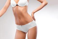 Perfect female body. Beautiful Woman in underwear Stock Photos
