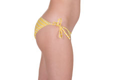 Perfect female body on the side in yellow swimming panties. Stock Photos