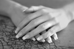 Perfect female hands on the map Stock Image