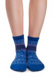 Perfect female legs in blue knitted socks Stock Images