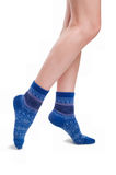 Perfect female legs in blue knitted socks Royalty Free Stock Photography