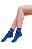 Perfect female legs in blue knitted socks Stock Photos