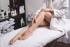 Perfect female legs close-up. Woman who takes care of her legs in spa centre. royalty free stock photography