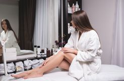 Perfect female legs close-up. Woman who takes care of her legs in spa centre. royalty free stock images