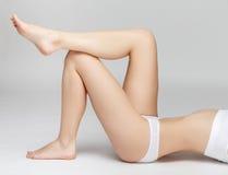 Perfect female legs on grey background Stock Photos