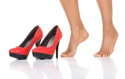Perfect female legs about to wear high heels Royalty Free Stock Image