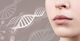Perfect female lips among DNA chains. Perfect female lips among DNA chains over gray background Royalty Free Stock Image