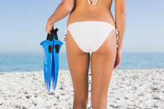 Perfect feminine buttocks of young woman holding fins Stock Images