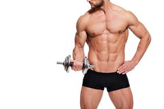 Perfect fit man. Young fit man holding a dumbbell, on white background Royalty Free Stock Photo