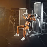 Perfect fit young athletic woman doing exercises on special spor. Sport, bodybuilding, lifestyle and people concept. Perfect fit young athletic woman doing Royalty Free Stock Photos