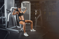 Perfect fit young athletic woman doing exercises on special spor Royalty Free Stock Image