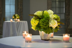 Perfect Flower Bouquet. The Bouquet of flowers with candles on a standing table during a wedding Royalty Free Stock Photography
