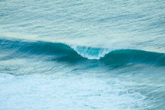 Perfect form. A perfect wave barreling left and right Royalty Free Stock Photo