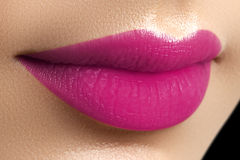 Perfect fuchsia lips. girl mouth close up. Beauty young wo Royalty Free Stock Photography