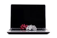 Perfect Gift for Everyone. Laptop Computer With Holiday Gift Bows Royalty Free Stock Photos