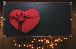 Perfect Gift, red heart box. Gift - Red heart Box on green background surrounded by light Stock Photography