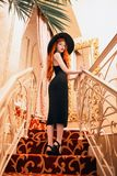 Perfect Girl In Classic Dress On Stairs. Noir Film. Luxury Vintage Woman. Lady In Classic Retro Hat. Sexy Redhead Woman In Royalty Free Stock Images