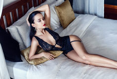 Perfect girl in a sexy black lingerie Stock Photos