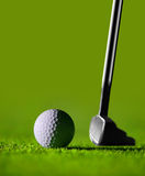 Perfect Golf. Golf Stick and Ball on the Green Grass with green background royalty free stock photography