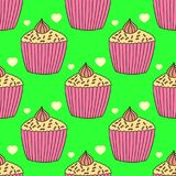 Perfect graphical seamless pattern with detailed drawn cupcakes and icing. Royalty Free Stock Image