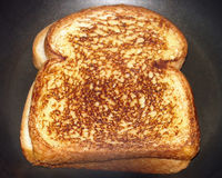 The perfect grilled cheese cooking Stock Images