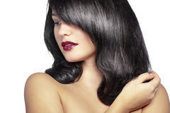 Perfect hair. Portrait of young beautiful woman with glossy hair Stock Image