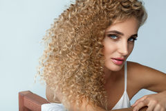 Perfect Hair. Beautiful Woman Model With Long Blonde Curly Hair Stock Photos