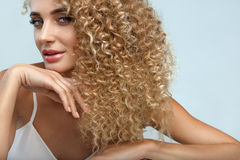 Perfect Hair. Beautiful Woman Model With Long Blonde Curly Hair Royalty Free Stock Image