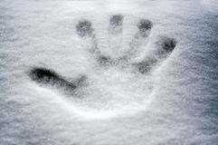 Perfect hand print in fresh snow, with blurred background of lake and mountain Stock Photo