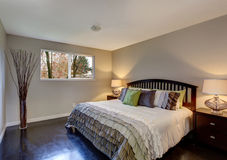 Perfect hardwood bedroom with ruffled bedding. Stock Image
